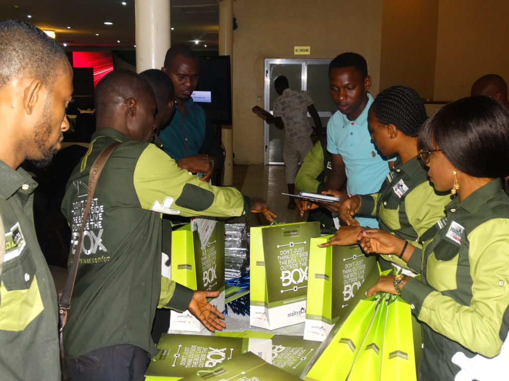 Staffs of Realty Point Limited preparing the goody bags moments before the official unveiling of Cedar Homes