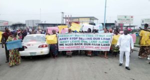 Women protest against alleged land-grabbing by military in Delta